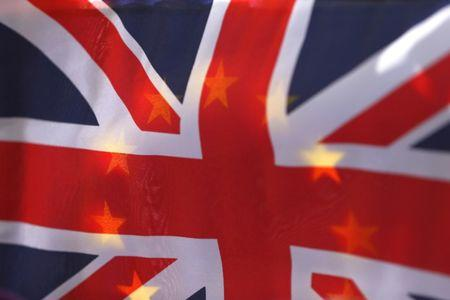 An EU flag is seen through a British Union flag during a pro-EU referendum event at Parliament Square in London