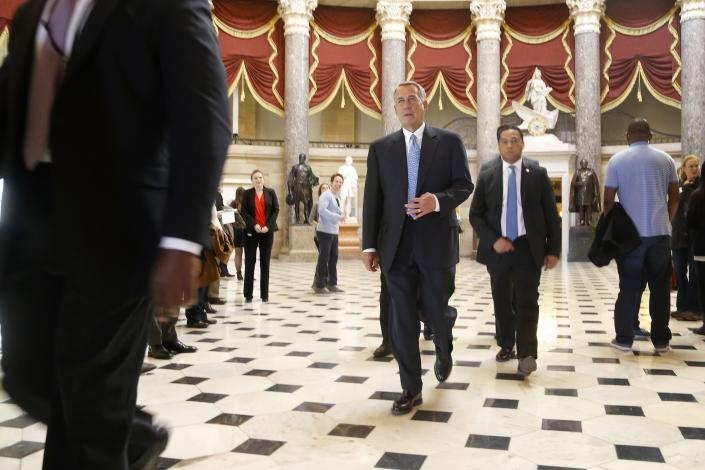 U.S. House Speaker John Boehner (R-OH) (C) walks to the House floor for procedural votes for legislation to fund the Department of Homeland Security at the Capitol in Washington, February 27, 2015. Congressional Republicans on Friday hoped to avoid a partial shutdown of the U.S. domestic security agency by finding votes to pass a three-week-long stopgap funding bill, which the White House said President Barack Obama would sign if it came to his desk. REUTERS/Jonathan Ernst (UNITED STATES - Tags: POLITICS)