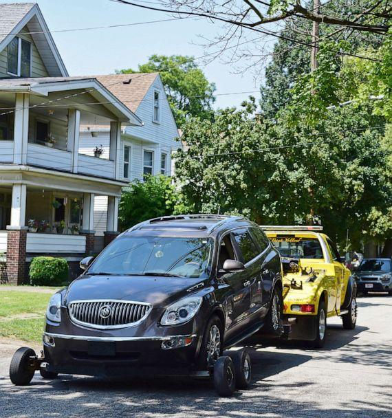 PHOTO: A vehicle is towed away from the crime scene where several bodies were found, July 9, 2019, in Cleveland.  (David Dermer/AP)