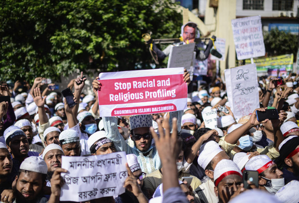Supporters of Islamist parties protest after Friday prayers in Dhaka, Bangladesh, Friday, Oct. 30, 2020. Thousands of Muslims and activists marched through streets and rallied across Bangladesh's capital on Friday against the French president's support of secular laws that deem caricatures of the Prophet Muhammad as protected under freedom of speech. (AP Photo/Mahmud Hossain Opu)