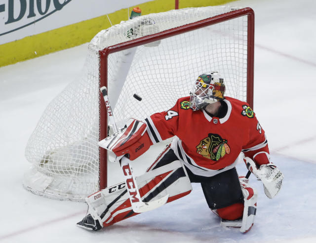 Chicago Blackhawks goaltender J-F Berube looks at the puck on a goal by Colorado Avalanche center Nathan MacKinnon during the second period of an NHL hockey game Tuesday, March 6, 2018, in Chicago. (AP Photo/Kamil Krzaczynski)
