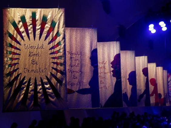 The runway was lined with banners asking what the world would look like if it was run by women (Getty)