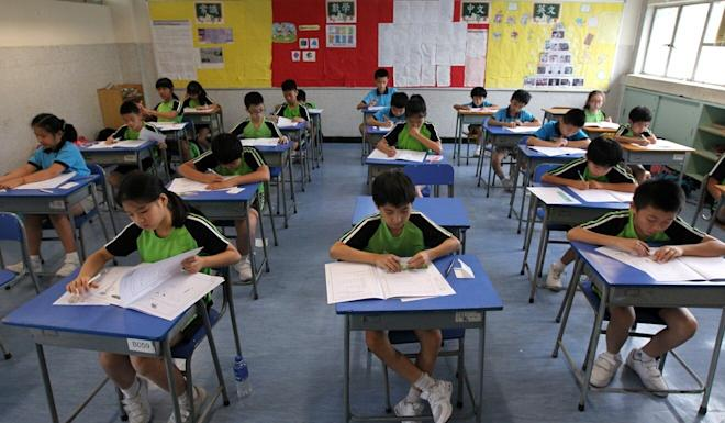 Students take a test to determine their secondary school placement. Photo: Roy Issa