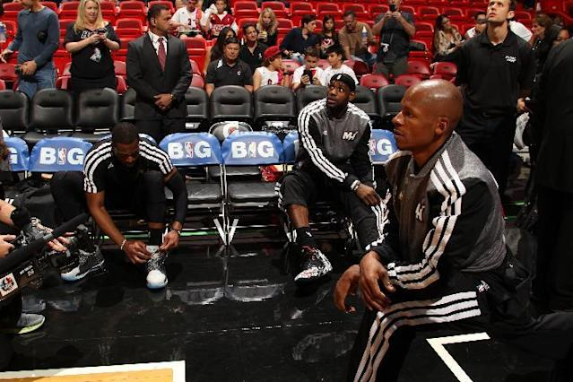 MIAMI, FL - JANUARY 26: LeBron James #6 and Dwyane Wade #3 and Ray Allen #34 of the Miami Heat get ready against the San Antonio Spurs at the American Airlines Arena in Miami, Florida on Jan. 26, 2014. (Photo by Issac Baldizon/NBAE via Getty Images)
