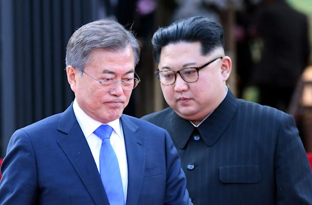 <p>South Korean President Moon Jae-In (L) and North Korean leader Kim Jong-Un (R) arrive to announce an agreement after signing a document at the Peace House on Joint Security Area (JSA) on the Demilitarized Zone (DMZ) in the border village of Panmunjom in Paju, South Korea, April 27, 2018. (Photo: Korea Summit Press Pool/EPA-EFE/REX/Shutterstock) </p>