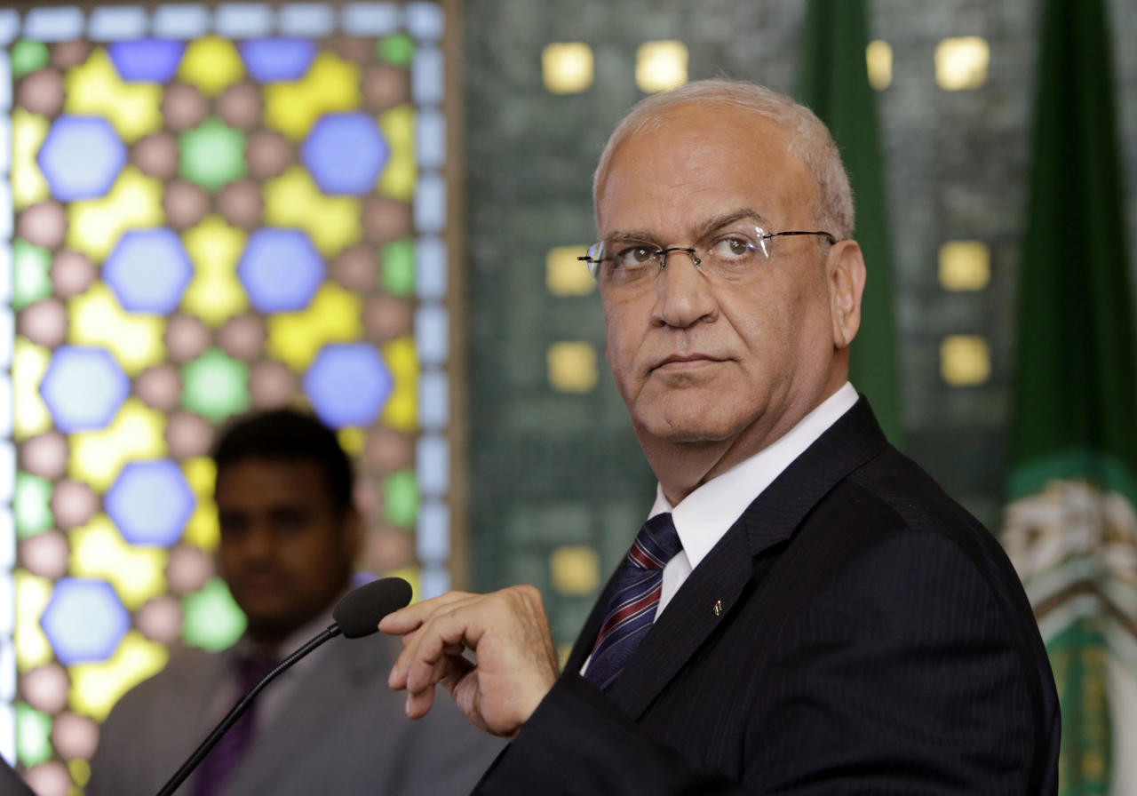 """<p> FILE - In this Aug. 11, 2014 file photo, Palestinian negotiator, Saeb Erekat, speaks during a news conference, following an emergency meeting at the Arab League headquarters in Cairo, Egypt. The Palestinians threatened Saturday to suspend all communication with the Trump administration if it follows through with plans to shutter their diplomatic mission in Washington, dealing a potentially major blow to President Donald Trump's hopes of securing an elusive Mideast peace deal. Erekat said the U.S. decision would undermine the peace process, calling the move """"very unfortunate and unacceptable."""" (AP Photo/Amr Nabil) </p>"""