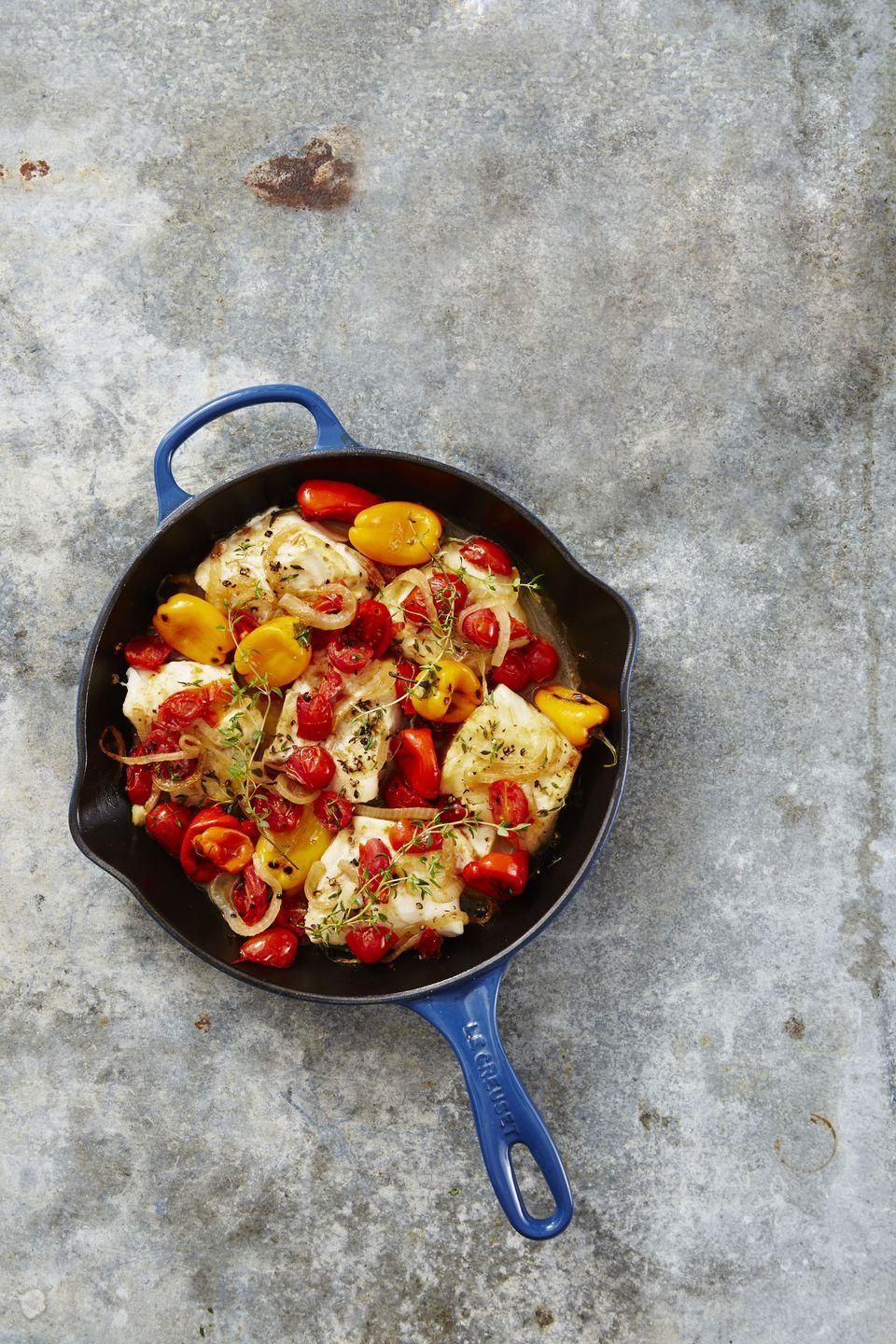 """<p>You'll sear this flaky cod on the stovetop for 10 minutes, and then follow up by finishing it off in a hot stove for another 10 minutes.</p><p><a href=""""https://www.goodhousekeeping.com/food-recipes/a40892/mediterranean-cod-recipe/"""" rel=""""nofollow noopener"""" target=""""_blank"""" data-ylk=""""slk:Get the recipe for Mediterranean Baked Cod »"""" class=""""link rapid-noclick-resp""""><em>Get the recipe for Mediterranean Baked Cod »</em></a></p>"""