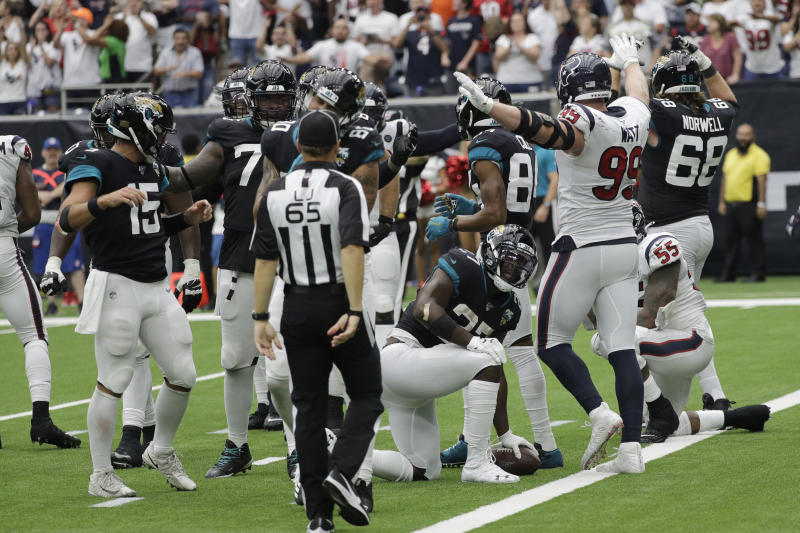 Houston Texans defensive end J.J. Watt (99) signals after Jacksonville Jaguars running back Leonard Fournette (27) was held short of the goal line on a two-point conversion attempt during the second half of an NFL football game Sunday, Sept. 15, 2019, in Houston. (AP Photo/David J. Phillip)