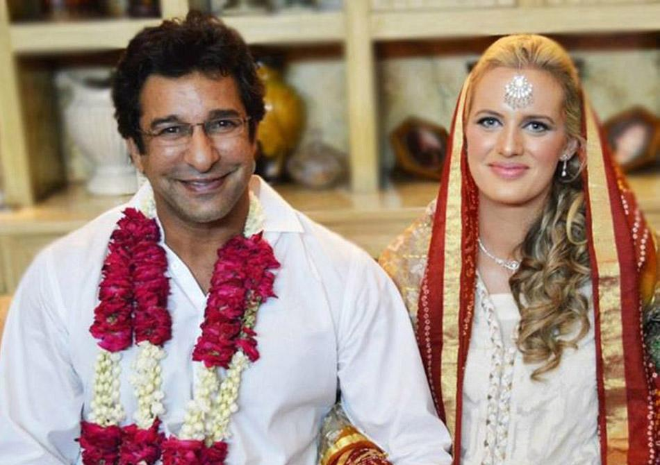 This handout photograph provided courtesy of Wasim Akram on August 21, 2013 shows former Pakistani cricket captain Wasim Akram (L) posing for a photograph with his Australian bride Shaniera Thompson during their wedding ceremony in Lahore on August 12, 2013. Famed Pakistan paceman Wasim Akram on August 21 announced that he had married his Australian girlfriend, Shaniera Thompson, saying he has started a new life on a happy note. AFP PHOTO/COURTESY OF WASIM AKRAM