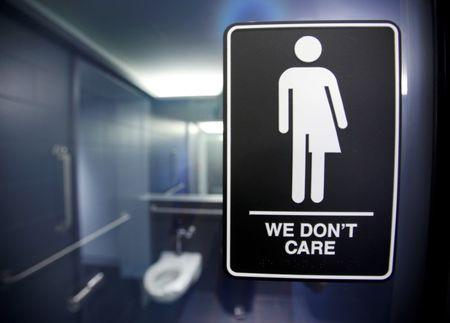 File photo of a sign protesting a recent North Carolina law restricting transgender bathroom access adorns one of the stalls at the 21C Museum Hotel in Durham, North Carolina