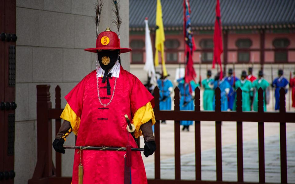 South Korean officials in royal guard uniforms perform during the changing of the guard ceremony at Gyeongbokgung palace in Seoul - JEON HEON-KYUN/EPA-EFE/Shutterstock