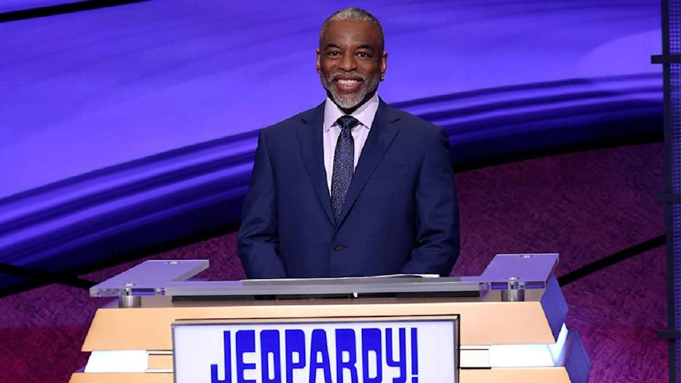 Levar Burton smiles behind the podium during his guest hosting stint on Jeopardy!