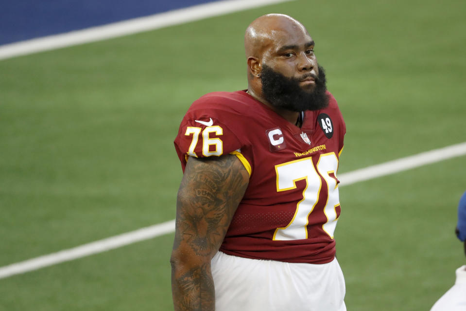 Washington Football Team offensive tackle Morgan Moses stands on the field before an NFL football game against the Dallas Cowboys in Arlington, Texas, Thursday, Nov. 26, 2020. (AP Photo/Roger Steinman)