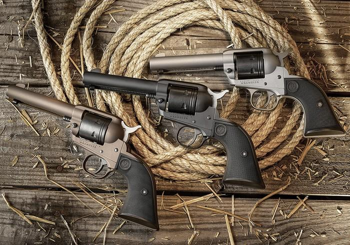Three pistols on coiled rope