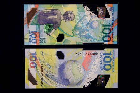 FILE PHOTO: The newly designed 100-rouble banknotes dedicated to the 2018 FIFA World Cup, are on display during a news conference in Moscow, Russia May 22, 2018. REUTERS/Sergei Karpukhin/File Photo