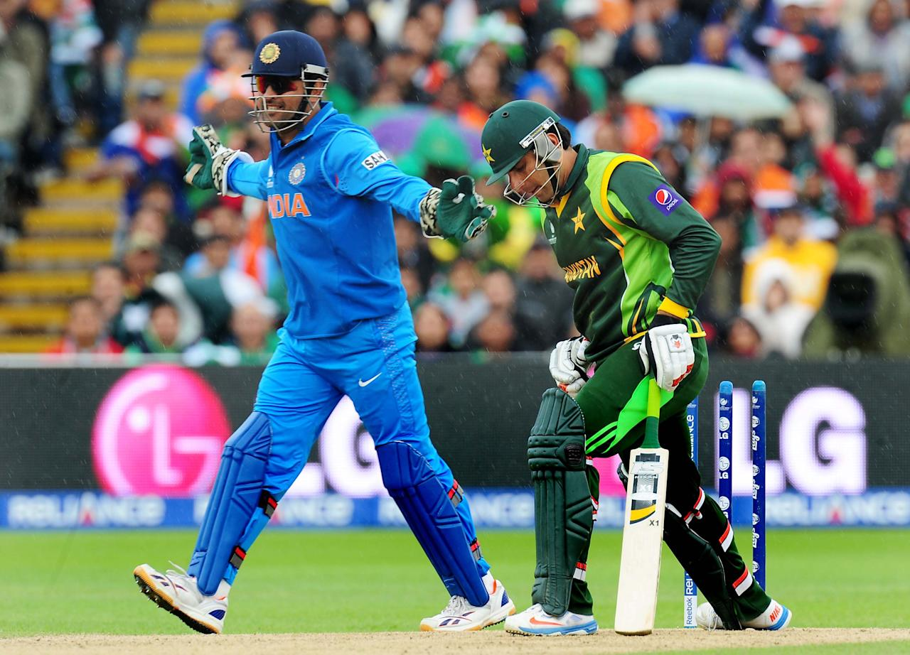 India's captain Mahendra Dhoni celebrates after Pakistan's Misbah-ul-Haq is bowled by India's Ravindra Jadeja for 22 during the ICC Champions Trophy match at Edgbaston, Birmingham.