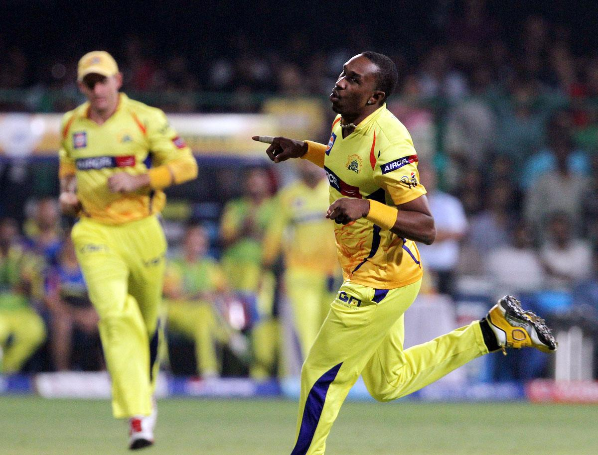 Chennai Super King player Dwayne Bravo celebrates after getting the wicket of Royal Challengers Bangalore player Chris Gayle during match 70 of the Pepsi Indian Premier League between The Royal Challengers Bangalore and The Chennai Super Kings held at the M. Chinnaswamy Stadium, Bengaluru  on the 18th May 2013. (BCCI)