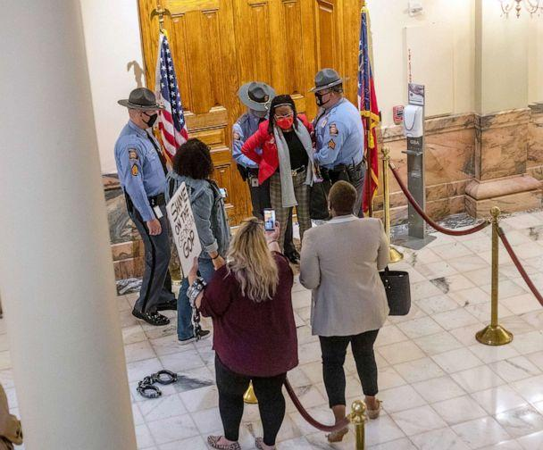 PHOTO: Rep. Park Cannon is placed in handcuffs by Georgia State Troopers after being asked to stop knocking on a door that leads to Gov. Brian Kemp's office at the State Capitol Building in Atlanta, March 25, 2021. (Atlanta Journal-Constitution via AP, FILE)