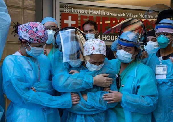 PHOTO: In this April 28, 2020, file photo, a nurse breaks down during the 7pm show of appreciation by Greenwich Village residents at Lenox Hill Medical Center in New York. (Kevin C. Downs/Redux, FILE)