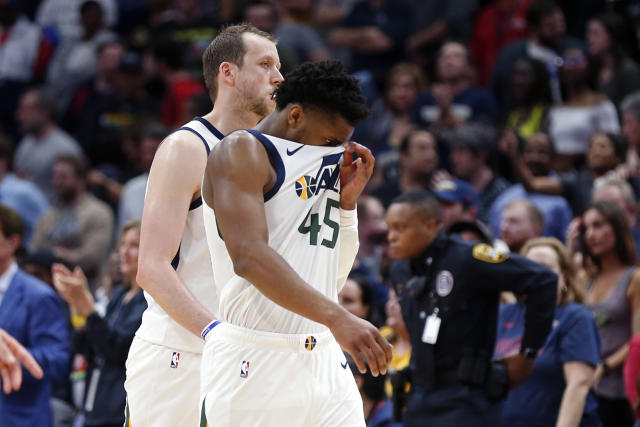 Utah Jazz guard Donovan Mitchell (45) walks to the bench at the conclusion of the team's NBA basketball game against the Utah Jazz in New Orleans, Thursday, Jan. 16, 2020. The Pelicans won 138-132 in overtime. (AP Photo/Gerald Herbert)