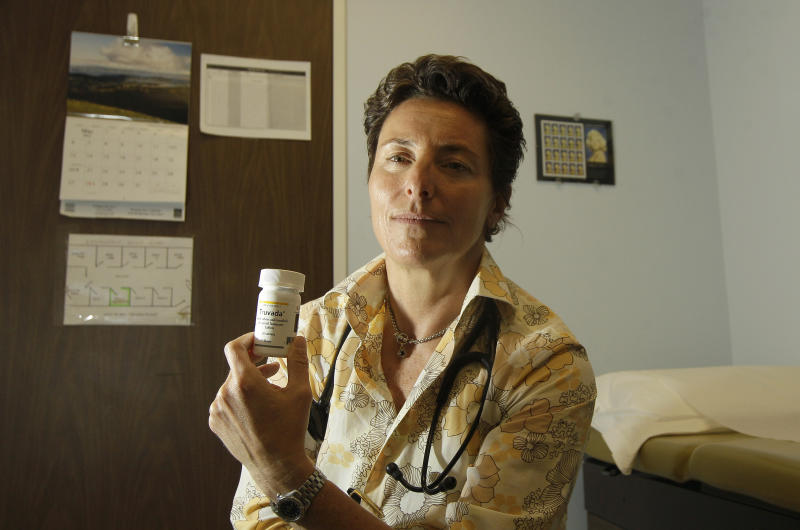 In this Thursday, May 10, 2012 photo, Dr. Lisa Sterman holds a bottle of Truvada pills at her office in San Francisco. Sterman prescribes the drug off-label for about a dozen patients at high risk for developing AIDS. The pill, already used to treat people with HIV, also helps prevent the virus from infecting healthy people. The Food and Drug Administration is expected to decide by June 15 whether the pill's maker Gilead Sciences should be allowed to formally market the drug for preventive use. (AP Photo/Jeff Chiu)
