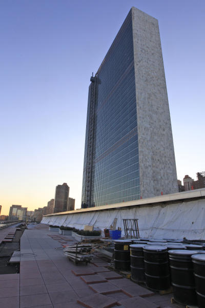 In this Thursday, Feb. 9, 2012 photo, the Secretariat building rises above the under-renovation delegates dining room terrace at United Nations headquarters. The first major renovation of the 60-year-old headquarters has been slowed by extra security measures, said New York architect Michael Adlerstein, the project's executive director and a U.N. assistant secretary-general. The final cost will be nearly $2 billion _ about 4 percent over the original budget. (AP Photo/Mary Altaffer)