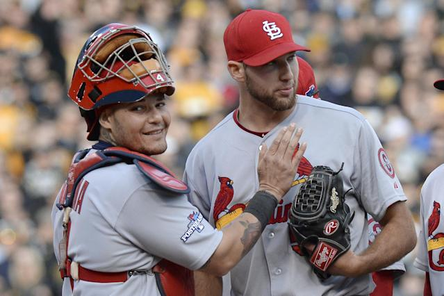 St. Louis Cardinals catcher Yadier Molina, left, pats starting pitcher Michael Wacha right before he was lifted from the baseball game in the eighth inning in Game 4 of a National League division series against the Pittsburgh Pirates on Monday, Oct. 7, 2013, in Pittsburgh. Wacha had a no-hitter going until Pirates' Pedro Alvarez hit a home run in that inning. (AP Photo/Don Wright)