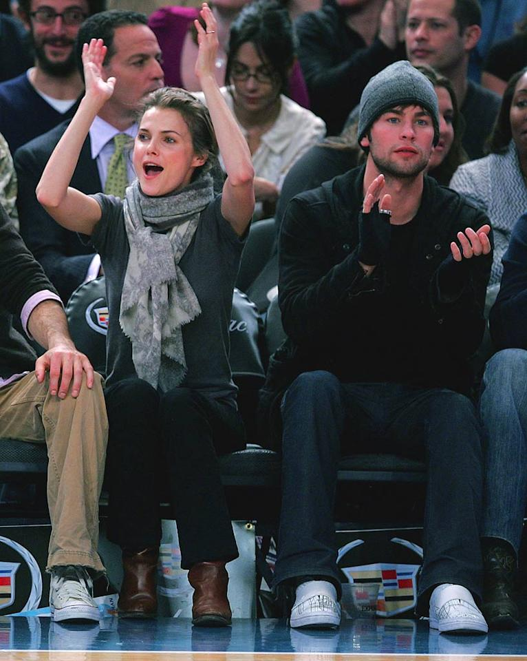 "Keri Russell and Chase Crawford don winter accessories inside Madison Square Garden during a Mavericks-Knicks game. The former star of ""Felicity"" opts for a scarf, while the ""Gossip Girl"" hunk goes with fingerless gloves and a cute hat. James Devaney/<a href=""http://www.wireimage.com"" target=""new"">WireImage.com</a> - December 10, 2007"