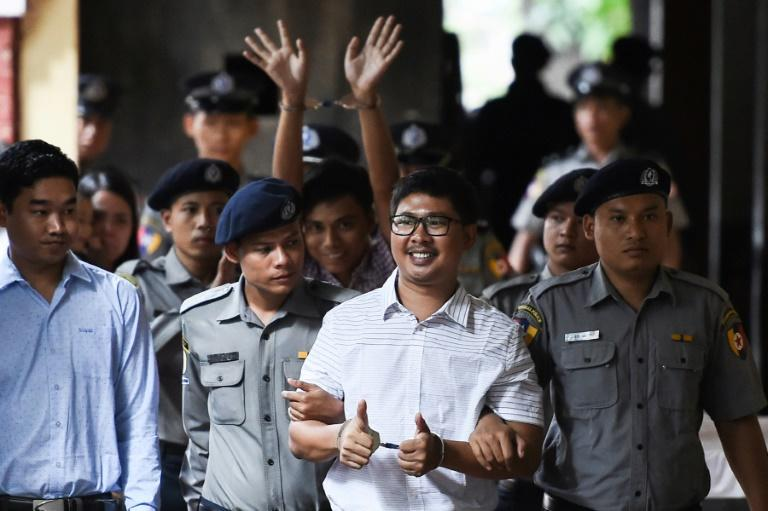 "UN chief Antonio Guterres said it was ""not acceptable"" for Reuters journalists Wa Lone (front) and Kyaw Soe Oo (C-back) to be jailed in Myanmar for doing their jobs"