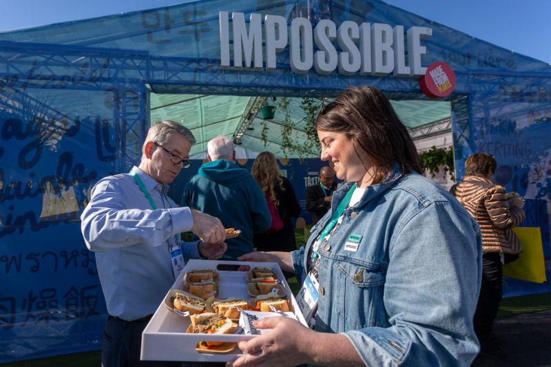 A woman serves Impossible Pork, a new plant-based pork product from Impossible Foods, at the 2020 Consumer Electronics Show (CES) in Las Vegas, Nevada on January 9, 2020. - CES is one of the shows largest technology companies on the planet, showing more than 4,500 exhibiting companies that represent the entire consumer technology ecosystem. (Photo by DAVID MCNEW / AFP) (Photo by DAVID MCNEW / AFP via Getty Images)