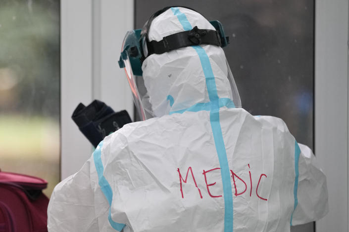 A medic wears a full protective outfit at the COVID-19 unit of the Marius Nasta National Pneumology Institute in Bucharest, Romania, Thursday, Sept. 23, 2021. Romania, which has the second lowest COVID-19 vaccination rate in the European Union, sees an accelerated increase of new infections over the past week, while health authorities currently report 1067 COVID-19 patients in ICU units and only 21 free COVID-19 ICU beds in the entire country, of which 3 in Bucharest. (AP Photo/Vadim Ghirda)