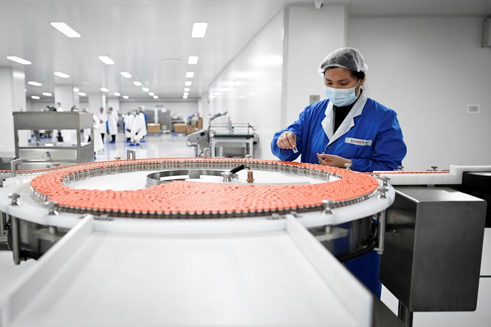 A staff member working during a media tour of a new factory built to produce a Covid-19 coronavirus vaccine at Sinovac