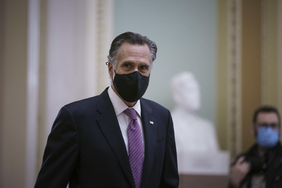 Sen. Mitt Romney, R-Utah, returns to the chamber from a short break as House impeachment managers present their second day of arguments in the Senate trial of former President Donald Trump, at the Capitol in Washington, Thursday, Feb. 11, 2021. (AP Photo/J. Scott Applewhite)