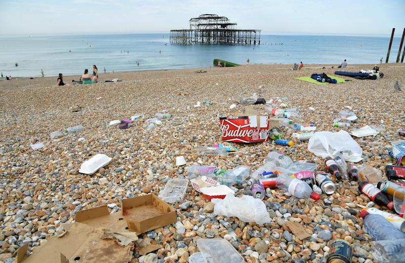 Litter is seen on the beach as people enjoy the sunny weather, amid the coronavirus disease (COVID-19) outbreak, in Brighton, Britain.
