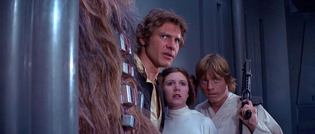 """<span style=""""font-weight:400;"""">When <strong>George Lucas's </strong>space opera first hit movie theaters in 1977, it was unlike anything the world had ever seen. If you ask anyone who saw the original </span><a href=""""https://bestlifeonline.com/star-wars-facts/?utm_source=yahoo-news&utm_medium=feed&utm_campaign=yahoo-feed"""" target=""""_blank""""><i><span style=""""font-weight:400;"""">Star Wars</span></i></a><span style=""""font-weight:400;""""> in theaters about their experience, they'll be able to tell you every little detail, right down to how long they waited in line. For a <a href=""""https://bestlifeonline.com/70s-movie-soundtracks/?utm_source=yahoo-news&utm_medium=feed&utm_campaign=yahoo-feed"""" target=""""_blank"""">'70s kid</a>, it's easy to get goosebumps just thinking about it.</span>"""