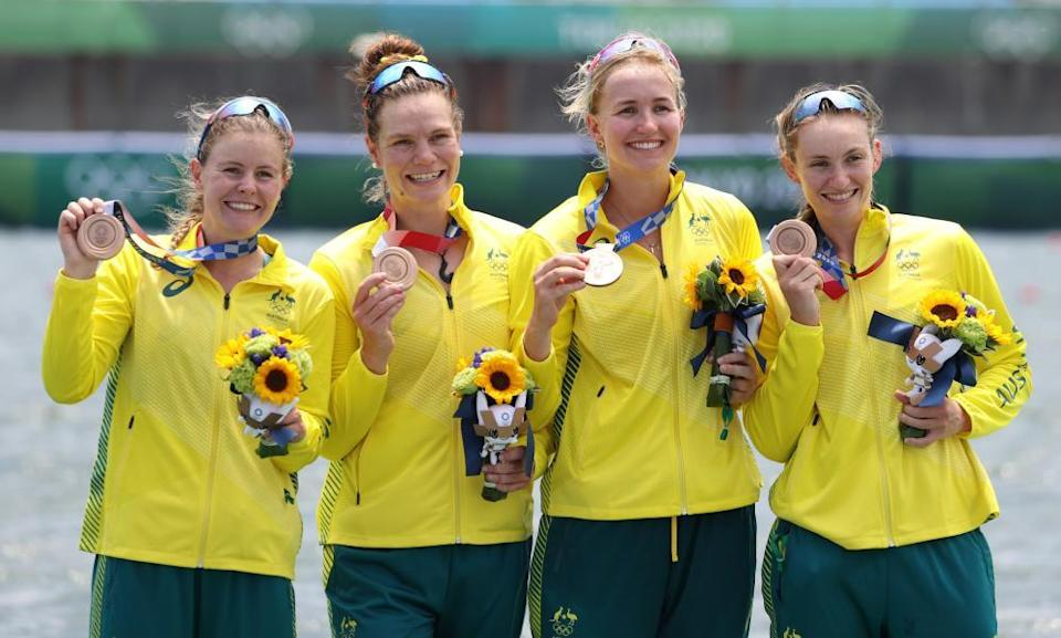 Team Australia poses for photos during the ceremony for rowing women's quadruple sculls.