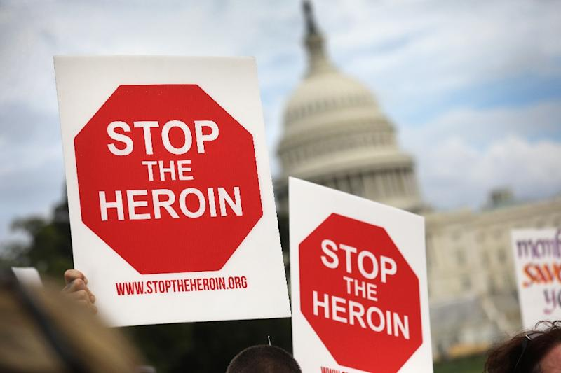 "Activists and family members of people who have died from opioid/heroin use take part in a ""Fed Up!"" rally at Capitol Hill in Washington, DC"