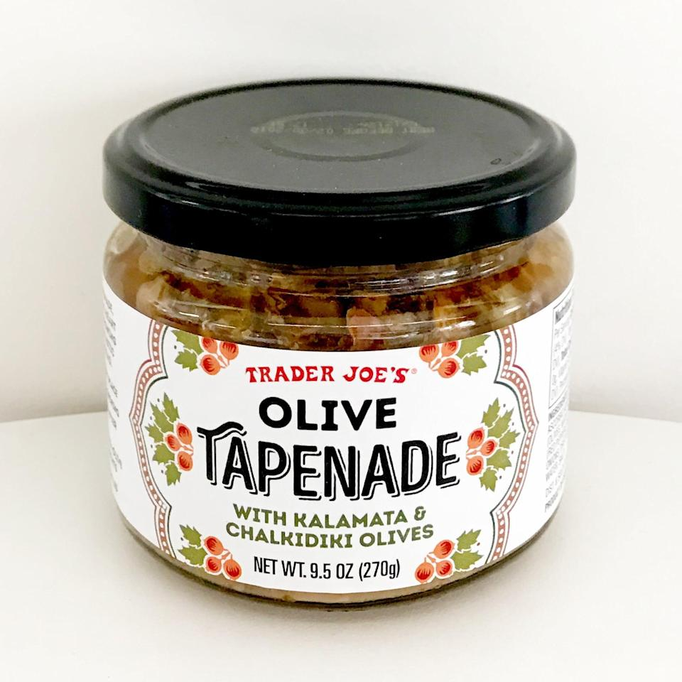 <p>Olive tapenade is a surefire hit at any gathering, and Trader Joe's Olive Tapenade gives you permission to buy a store version and skip the effort of homemade. With both kalamata and Chalkidiki olives, the jar is equal parts black and green olives to please parties of both preference. Serve it with pita chips, crackers, or toasted baguette. </p>