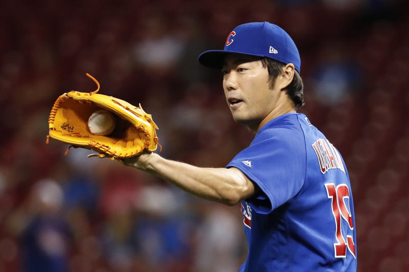 FILE - In this Aug. 23, 2017, file photo, Chicago Cubs relief pitcher Koji Uehara prepares to throw during the eighth inning of the team's baseball game against the Cincinnati Reds in Cincinnati. Uehara, whose dominant season in relief helped the Boston Red Sox win the 2013 World Series, has retired with Japan's Yomiuri Giants, the team that he first played for in Japan. (AP Photo/John Minchillo, File)