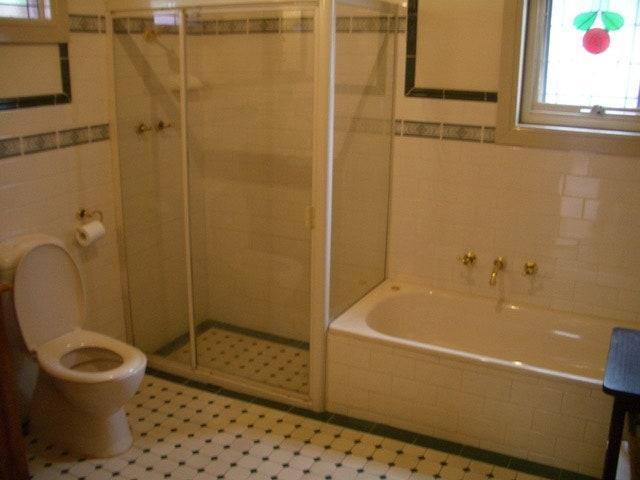 BEFORE: The bathroom, while functional, was dark and didn't fit the couple's taste.