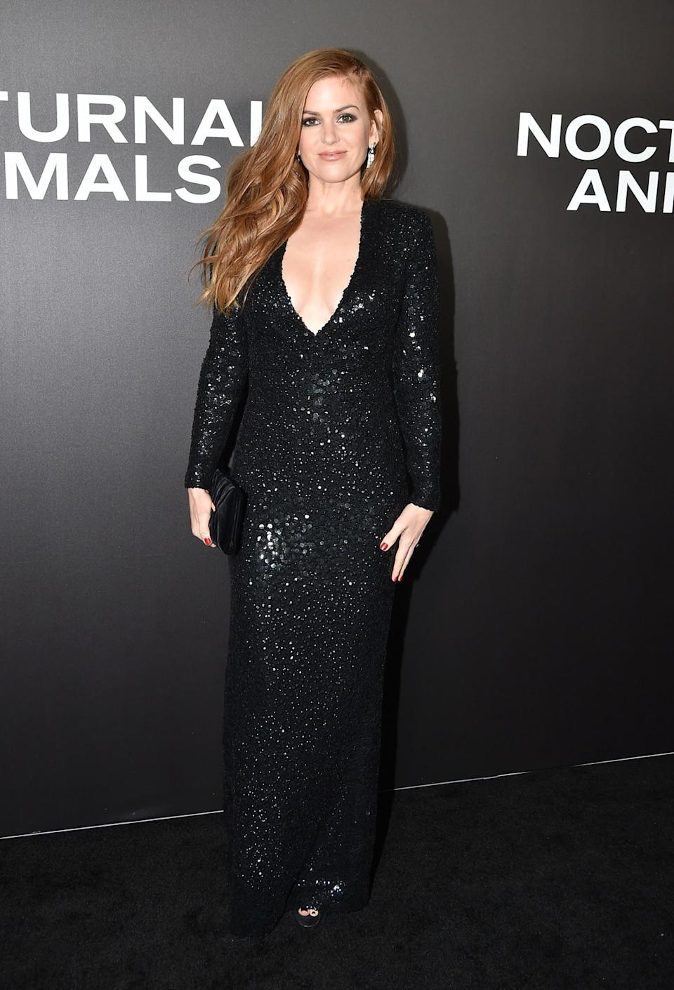 <p>Isla opted for a bedazzled black gown with a low-cut neckline at the star-studded premiere. <i>[Photo: Getty]</i> </p>