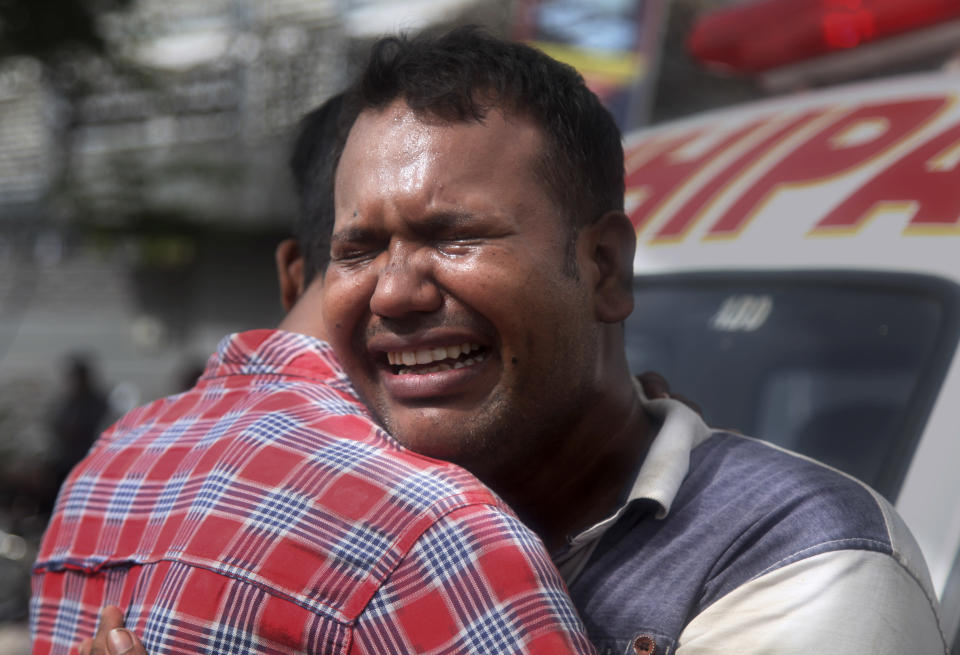 A man mourns over death of his family member in the chemical factory fire, outside the morgue of a hospital, in Karachi, Pakistan, Friday, Aug. 27, 2021. A massive fire broke out at a chemical factory in Pakistan's southern port city of Karachi on Friday, killing some workers and injuring several others, police and a government spokesman said. (AP Photo/Ikram Suri)