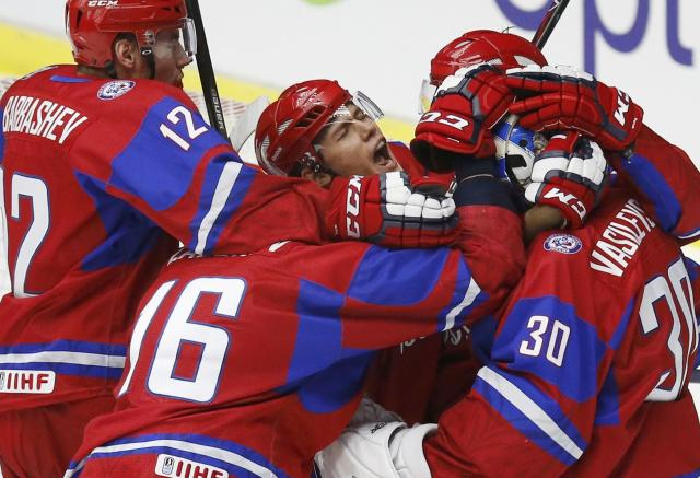 Russia's Andrei Mironov celebrates with teammates after they defeated Canada to win the bronze medal in their IIHF World Junior Championship ice hockey game in Malmo, Sweden, January 5, 2014. REUTERS/Alexander Demianchuk (SWEDEN - Tags: SPORT ICE HOCKEY)