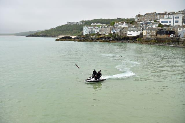 Police officers on a jet ski patrol the bay in St Ives during the G7 summit in Cornwall