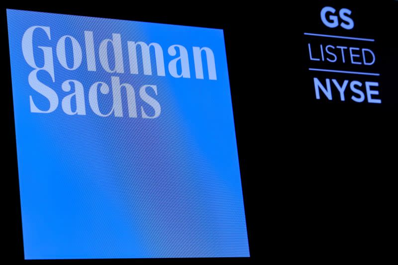 FILE PHOTO: The ticker symbol and logo for Goldman Sachs is displayed on a screen on the floor at the NYSE in New York