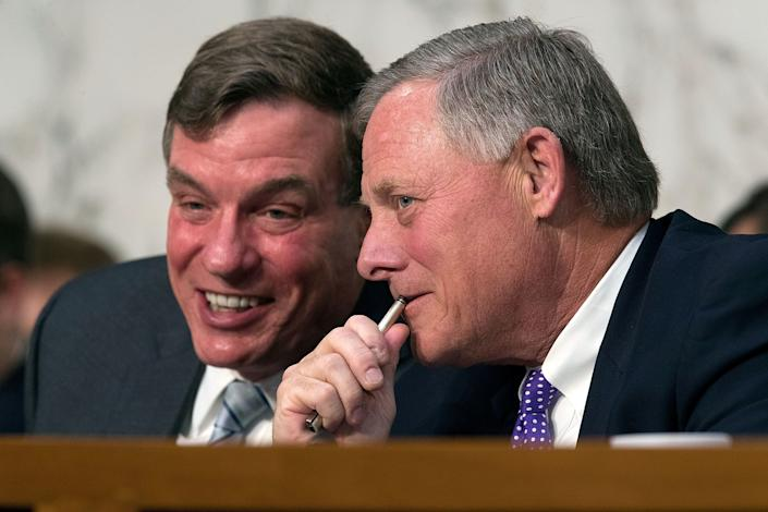 Senate Intelligence Committee Chairman Richard Burr (R-N.C.), right, and ranking member Sen. Mark Warner (D-Va.) talk during a hearing with the heads of the U.S. intelligence agencies in the Hart Senate Office Building on Capitol Hill on May 11, 2017.