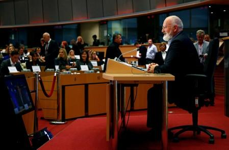 FILE PHOTO: European Commissioner-designate for European Green Deal Frans Timmermans of Netherlands attends his hearing before the European Parliament in Brussels