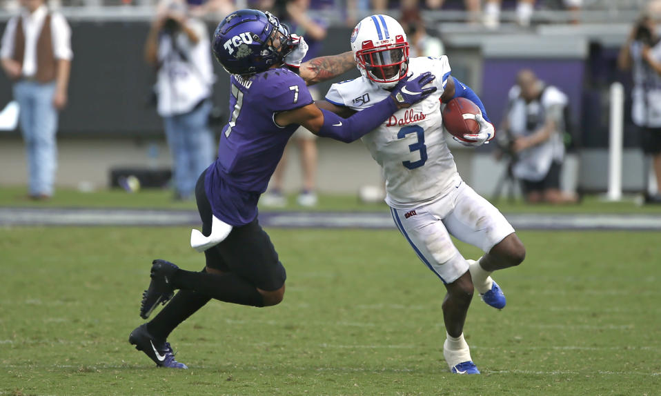 TCU safety Trevon Moehrig (7) pushes SMU wide receiver James Proche (3) toward the sideline after Proche caught a pass during the first half of an NCAA college football game Saturday, Sept. 21, 2019, in Fort Worth, Texas. (AP Photo/Ron Jenkins)