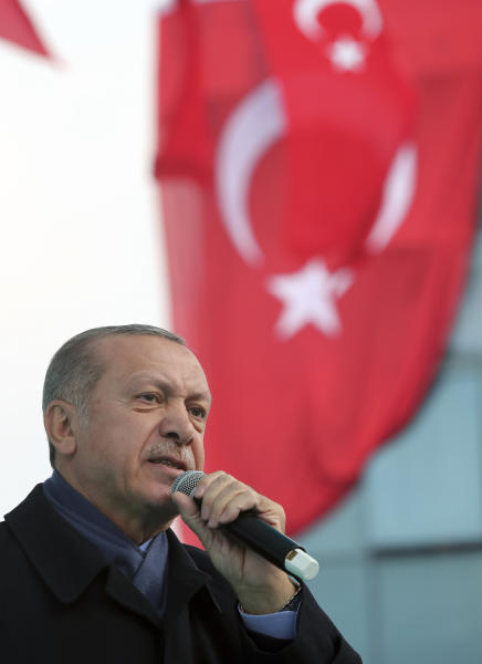 Turkish President Recep Tayyip Erdogan, delivers a speech at supporters in Istanbul, Sunday, Oct. 21, 2018. Erdogan says he will announce details of the Turkish investigation into the death of Saudi writer Jamal Khashoggi's on Tuesday, in a speech to ruling party members in parliament. (Presidential Press Service via AP, Pool)