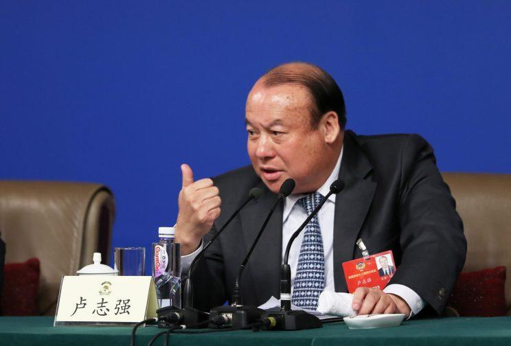Lu Zhiqiang, the CEO of China Oceanwide, talks at a press conference in Beijing. Source: Reuters